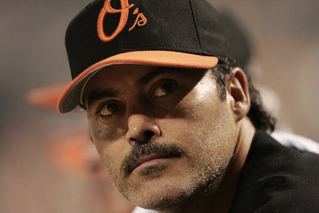 BALTIMORE - AUGUST 12: Rafael Palmeiro #25 of the Baltimore Orioles watches from the dugout as his team plays against the Toronto Blue Jays August 12, 2005 at Oriole Park at Camden Yards in Baltimore, Maryland. Palmeiro was named in the Mitchell Report that was released December 13, 2007 by a committee looking into use of performance-enhancing drugs in Major League Baseball and headed by former Senate Majority Leader George Mitchell. (Photo by Win McNamee/Getty Images)