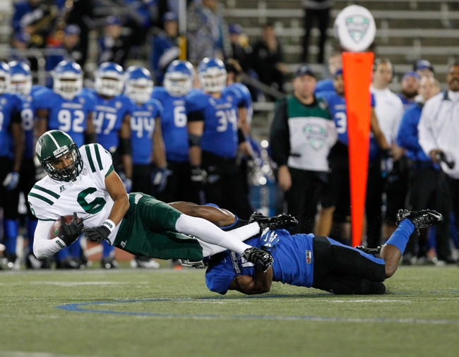 Nov 5, 2013; Buffalo, NY, USA; Buffalo Bulls defensive back Marqus Baker (5) tackles Ohio Bobcats wide receiver Sebastian Smith (6) during the second half at University of Buffalo Stadium. Buffalo beat Ohio 30-3. Mandatory Credit: Kevin Hoffman-USA TODAY Sports