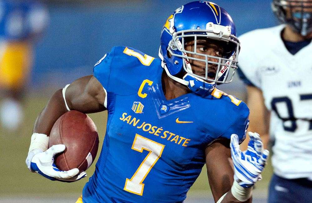 Sep 3, 2015; San Jose, CA, USA; San Jose State Spartans running back Tyler Ervin (7) rushes for a gain against the New Hampshire Wildcats during the third quarter at Spartan Stadium. The San Jose State Spartans defeated the New Hampshire Wildcats 43-13. Mandatory Credit: Ed Szczepanski-USA TODAY Sports