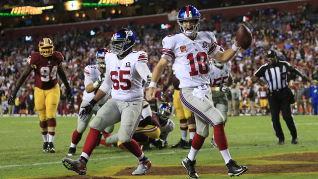LANDOVER, MD - SEPTEMBER 25: Quarterback Eli Manning #10 of the New York Giants celebrates his 4th quarter touchdown against the Washington Redskins at FedExField on September 25, 2014 in Landover, Maryland. (Photo by Rob Carr/Getty Images)