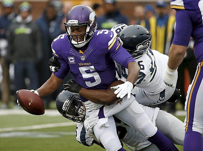 Minnesota Vikings quarterback Teddy Bridgewater (5) is sacked by Seattle Seahawks defenders in the first half of an NFL football game Sunday, Dec. 6, 2015 in Minneapolis. (AP Photo/Ann Heisenfelt)